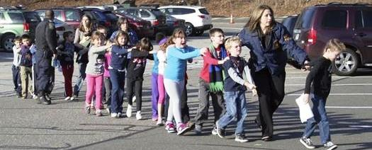Connecticut State Police lead children from the Sandy HookElementary School in Newtown, Conn., following a reported shooting there. AP Photo/Newtown Bee, Shannon Hicks