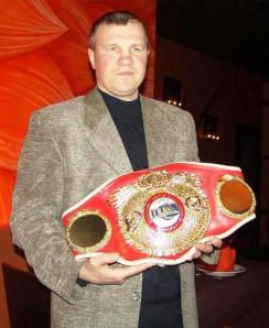 Sergey Artemiev with the World Champion belt