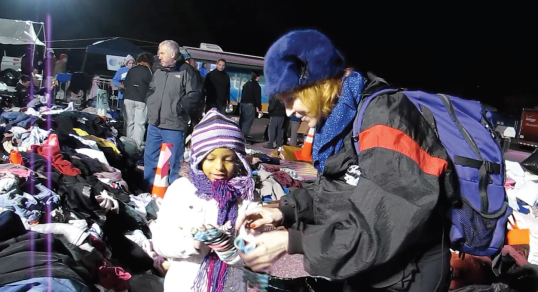 Dr.Judy comforting a child after Superstorm Sandy at Miller Field