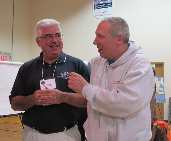 Friends Scott McGrath and Victor Dolan, both Sandy survivors, sharing at te civic meeting